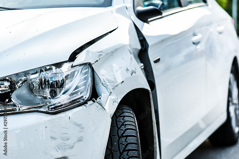 Car crash or accident. Front fender and light damage and scratchs on bumper. Broken vehicle detail or close up. - obrazy, fototapety, plakaty