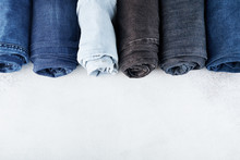 Row Of Different Rolled Jeans ...