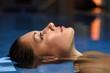 canvas print picture - Junge Frau im Pool eines Spa