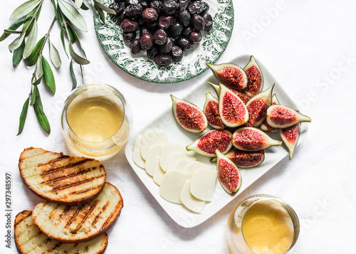 Canvas Print Turkish sun dried olives, figs, homemade cheese, white wine - delicious appetize
