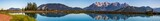 High resolution stitched panorama of a beautiful alpine view with reflections in a lake at Fieberbrunn, Tyrol, Austria