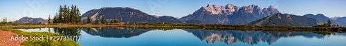 High resolution stitched panorama of a beautiful alpine view with reflections in a lake at Fieberbrunn, Tyrol, Austria - 297351717