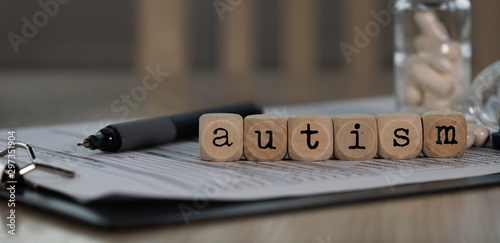 Word AUTISM composed of wooden dices. Wallpaper Mural