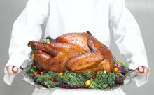 Thanksgiving Turkey On A Platter Being Carried By A Chef