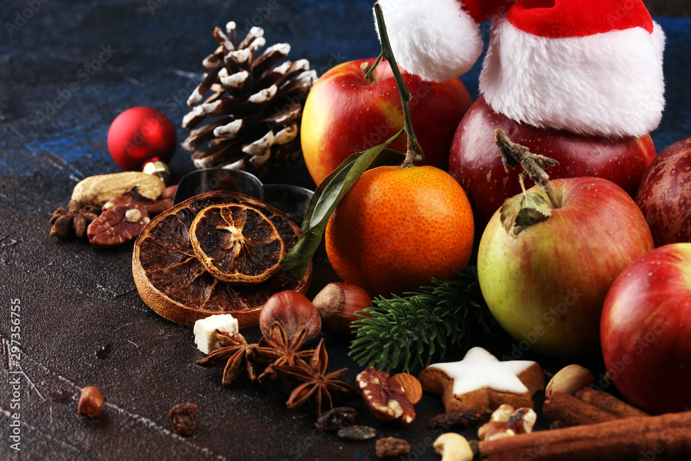 Fototapeta christmas cookies and santa had with spieses, nuts and fruits on rustic table