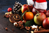 Fototapeta Kawa jest smaczna - christmas cookies and santa had with spieses, nuts and fruits on rustic table