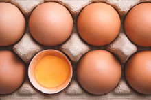 Top View And Close Up Image Of Organic Chicken Eggs Are One Of The Food Ingredients In Egg Box To Prepare For Cooking. Organic Chicken Eggs Food Ingredients Concept.