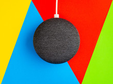 Smart Home Device Speaker On Coloured Triangle Background