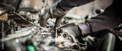 Close up of car mechanic repairer technician repairs auto engine Canvas Print