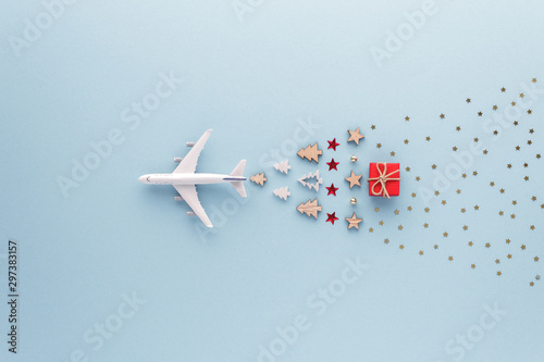 Spoed Fotobehang Kerstmis Christmas composition. Airplane flying in sky star gift bauble set top view background with copy space for your text. Flat lay.
