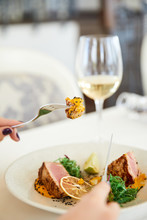 Slice Of A Tasty Tuna Meal With Glass Of White Wine At The Restaurant