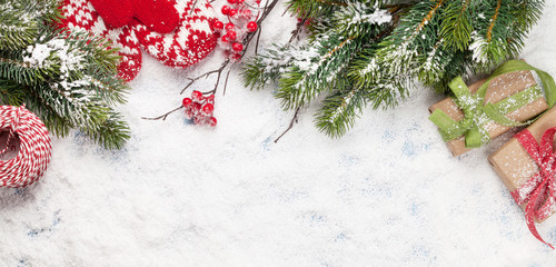 Fototapeta na wymiar Christmas greeting card with gift boxes, decor and fir tree