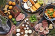 Christmas dinner table with roast beef, appetizers platter and traditional cookies. Christmass celebration, festive family dinner.  Overhead view.