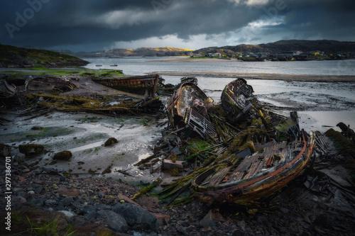 Abandoned ships cemetery at low tide near Teriberka village in Murmansk Region. Kola peninsula, Northern Russia