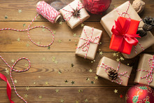 Christmas Background With Gift Boxes Wraped In Craft Paper Over Wooden Table Prepared For Celebrating Festive Holiday Season. Copy Space.