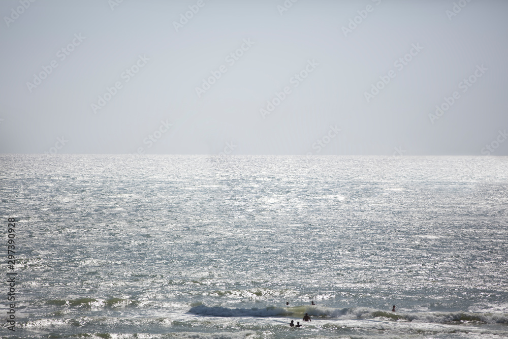 Fototapety, obrazy: Sea sky and people silhouettes swimming