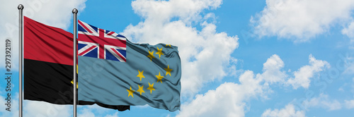 Cuadros en Lienzo  Angola and Tuvalu flag waving in the wind against white cloudy blue sky together