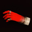canvas print picture Plastic red hand in fashion jewelry accessories.Bracelets and rings. Stylish minimal concept