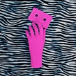 canvas print picture Pink hand and pink audio cassette. Zebra animal print. Minimal art