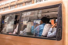 People Travelling In Bus