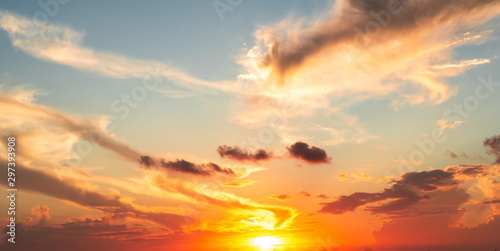 Foto  Dramatics orange and red sunset or sunrise sky with clouds for background