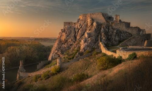 Staande foto Oude gebouw Golden color of Devin castle during the sunset, Slovakia.