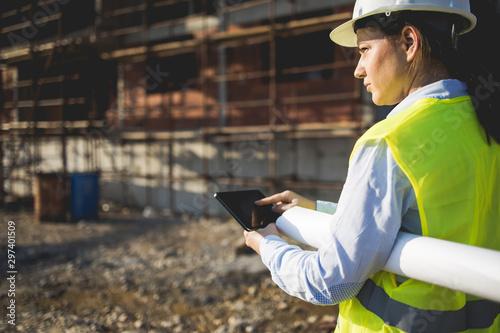 Fotografiet  A woman construction worker on building site