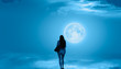 """Leinwandbild Motiv Beautiful woman walks on the clouds and Night sky with full moon """"Elements of this image furnished by NASA"""