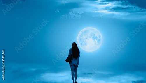 Foto auf Gartenposter Blau Jeans Beautiful woman walks on the clouds and Night sky with full moon