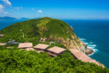 Beautiful Bungalows and boulders on the top of Boundary island near Sanya, Hainan island, China and South China sea, Asia