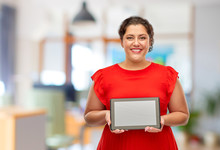 Technology, People And Internet Concept - Happy Woman In Red Dress Holding Tablet Pc Computer With Blank Screen Over Office Background