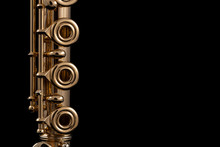 A Part Of A Gold Plated Flute On A Black Background. An Instrument Common In The Symphony Orchestra