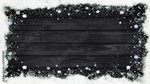 Fototapeta  winter Background - Frame made of snow on wooden texture, top view with space fo
