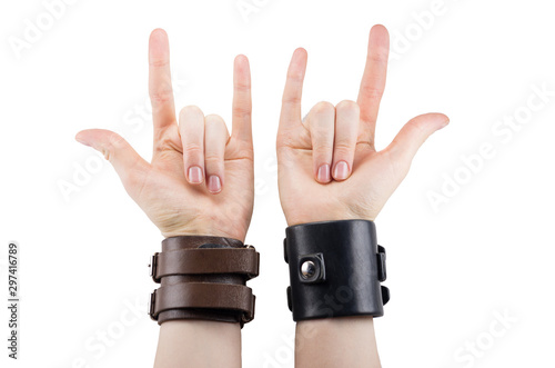 Canvas Print hand with leather rocker bracelet with rock and roll sign, rock music isolated o