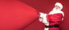 Real Santa Claus Smiling,holding Big Gift Bag.