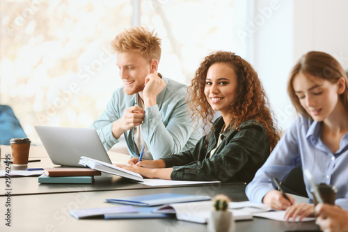 Group of students preparing for exam in university Canvas Print
