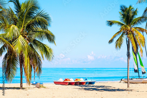 The tropical beach of Varadero in Cuba with sailboats and palm trees on a summer day with turquoise water Canvas Print