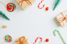 Christmas Composition. Gift Boxes, Toy Fir Tree, Cande Cane On White Background. Copy Space, Flat Lay, Top View Christmas Or New Year Minimal Concept.