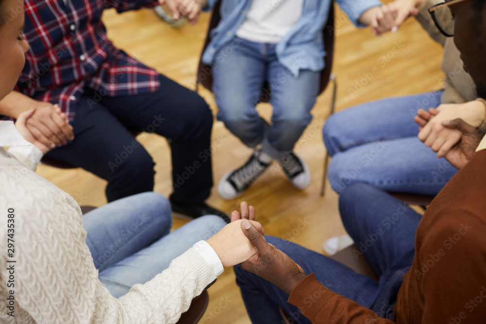 Fototapety, obrazy: High angle closeup of unrecognizable people sitting ion circle and holding hands during support group meeting, cpy space