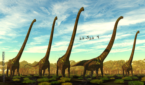 Obraz na plátně  Mamenchisaurus youngi Dinosaur Herd - Mamenchisaurus youngi was a sauropod dinosaur that lived in China during the Jurassic Period