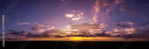 Fototapety, obrazy: Panorama Top view Aerial photo from flying drone over village in Thailand.Cumulus sunset clouds with sun setting down on dark background.