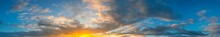 Panorama Sunlight With Dramatic Sky. Cumulus Sunset Clouds With Sun Setting Down On Dark Background.Vivid Orange Cloud Sky.