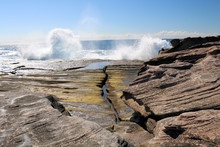 Waves Breaking Over The Rock P...