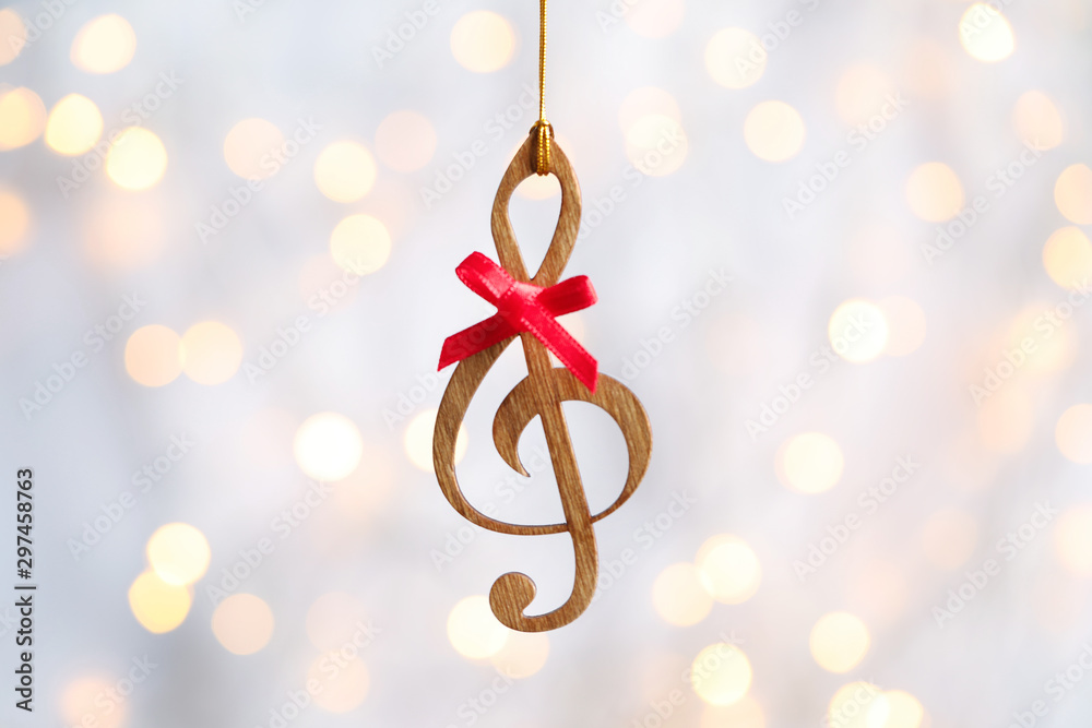 Fototapety, obrazy: Wooden treble clef against blurred lights. Christmas music