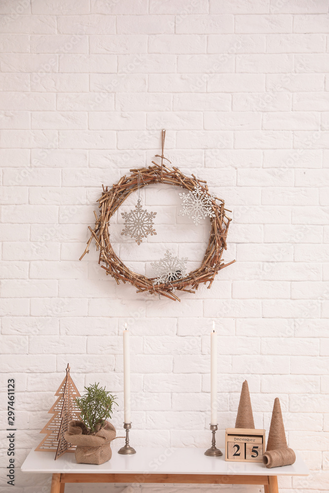 Fototapety, obrazy: Console table with Christmas decoration near brick wall. Idea for festive interior