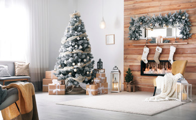 Festive interior with decorated Christmas tree and fireplace