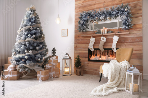 Valokuvatapetti Festive interior with decorated Christmas tree and fireplace