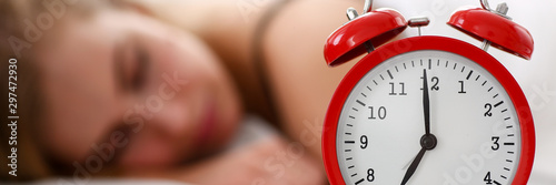 Obraz Young beautiful woman sleep well in the morning alarm - fototapety do salonu