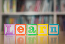 The Word 'learn' With Toys And Books. Children Reading And Academics.