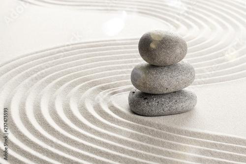 Photo Zen stones in the sand. Beige background